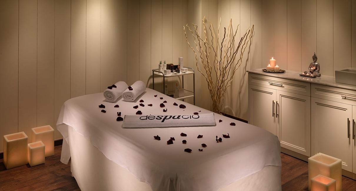 Luxury candle-lit massage room