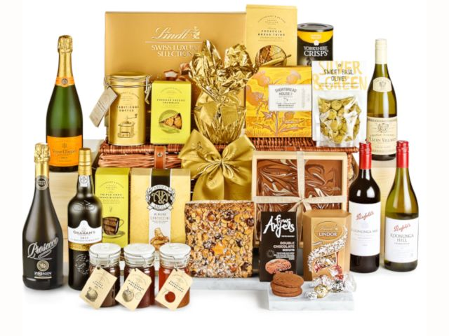 Multiple bottles of prosecco and champagne alongside luxury boxes of chocolate and other luxury food products