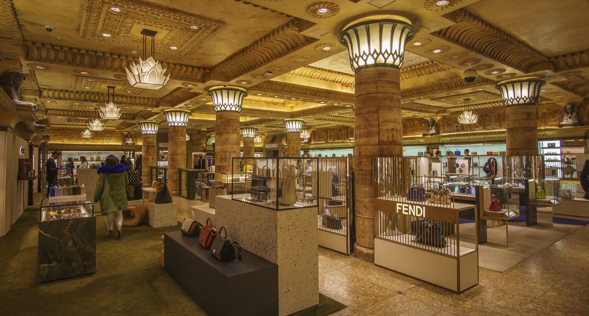 Harrods store interior, cases containing luxury handbags and womens shoes