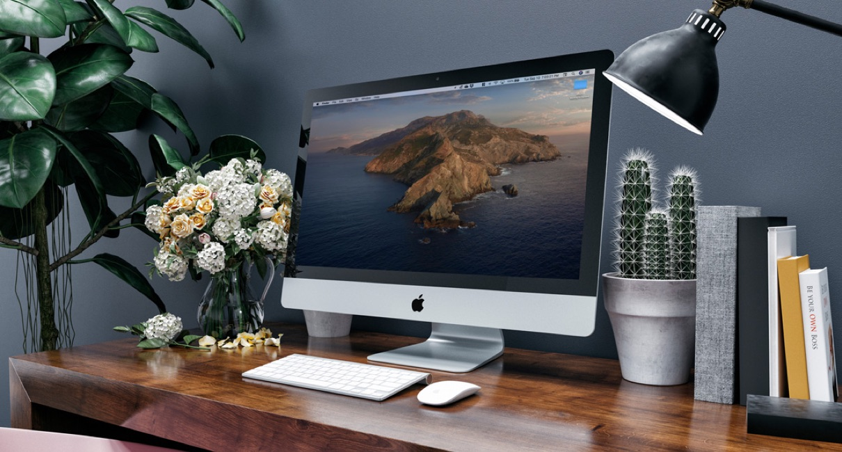 iMac on a clean white desk with magic keyboard and magic pad