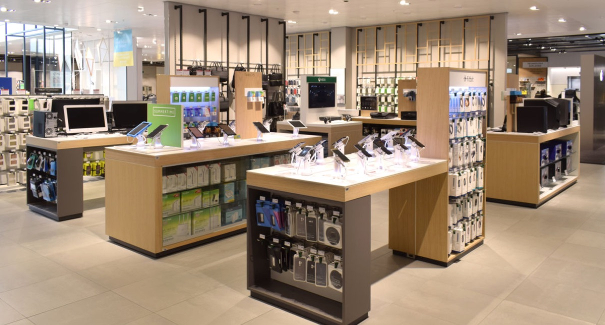 iPhones and tablets on display in department store