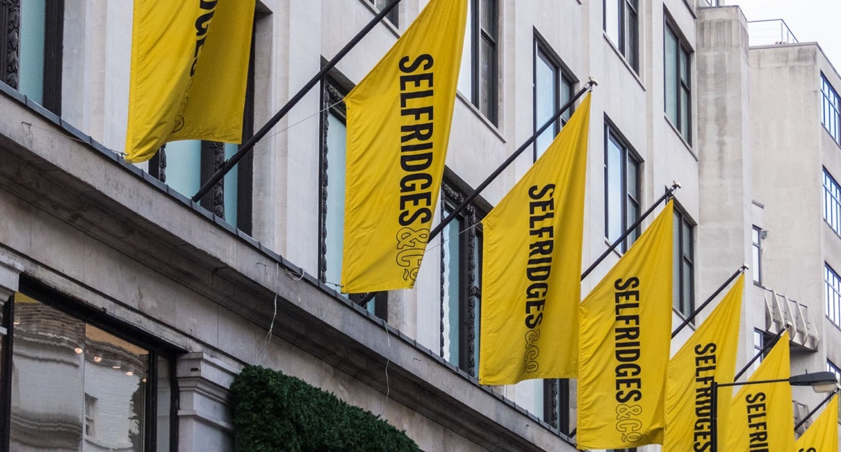 Yellow Selfridges flags on Oxford street store