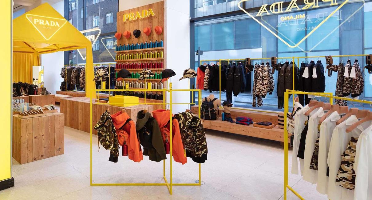 Selfridges store interior featuring Prada clothes on rails