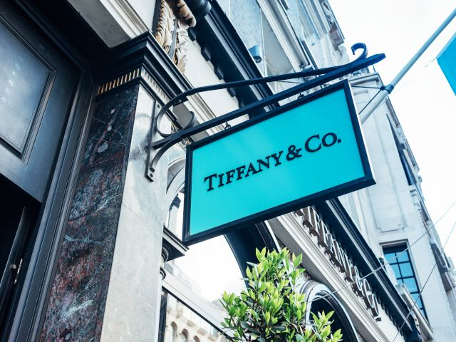 Tiffany and Co blue sign attached to a black marble storefront